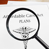 insurance plans under magnifying glass