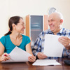elder couple holding paper