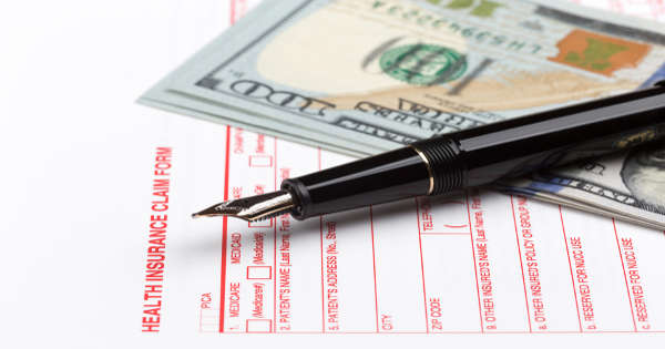 health insurance form pen and money