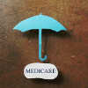 umbrella with medicare written underneath